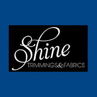 SHINE TRIMMINGS AND FABRICS logo
